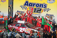Apr 26, 2008; Talladega, AL, USA; NASCAR Nationwide Series driver Tony Stewart (20) celebrates after winning the Aarons 312 at the Talladega Superspeedway. Mandatory Credit: Mark J. Rebilas-