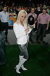 """SAT.1-Show """"Jetzt geht's um die Eier"""" am 08.04.2006 bei Gerry Weber, Halle. Cora Schumacher in weiŖen Stiefeln posiert mit einem schwarzen Ei in der Hand.<br /> Foto: © nordphoto *** Local Caption *** Foto ist honorarpflichtig! zzgl. gesetzl. MwSt.<br />  Belegexemplar erforderlich"""