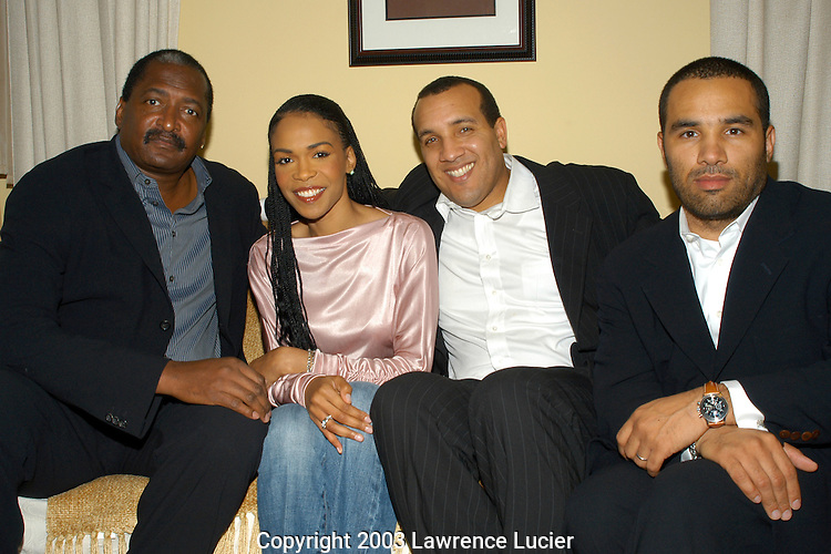 NEW YORK - DECEMBER 11:  (L-R) Manager Matthew Knowles, recording artists Michelle Williams of Destiny's Child, Sony Urban Music executive vice president David McPherson, and Sony Urban Music senior vice president Rodney Shealey appear December 11, 2003 backstage before Williams' opening night in the Broadway musical Aida at the Palace Theater in New York City.