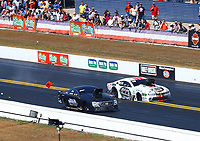 Mar 19, 2017; Gainesville , FL, USA; NHRA pro mod driver Mike Janis (far) crosses the centerline and hits a timing block alongside Steven Whiteley during the Gatornationals at Gainesville Raceway. Mandatory Credit: Mark J. Rebilas-USA TODAY Sports