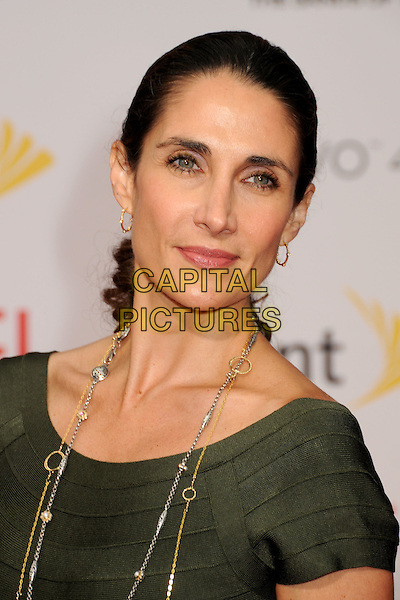"MELINA KANAKAREDES.""Prince Of Persia: The Sands Of Time"" Los Angeles Premiere held at Grauman's Chinese Theatre, Hollywood, California, USA..May 17th, 2010.headshot portrait green hoop earrings  gold silver necklaces .CAP/ADM/BP.©Byron Purvis/AdMedia/Capital Pictures."