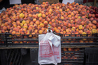 Plastic bags at the Union Square Greenmarket in New York on Wednesday, August 21, 2013. Members of the NY City Council are proposing a bill that would require merchants to charge shoppers 10 cents for every bag used in order to encourage people to reuse or bring their own bags. (© Richard B. Levine)