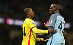 Odion Ighalo of Watford objects to Yaya Toure of Manchester City not putting out the ball for the injured Roberto Pereyra of Watford during the English Premier League match at The Etihad Stadium, Manchester. Picture date: December 12th, 2016. Photo credit should read: Lynne Cameron/Sportimage