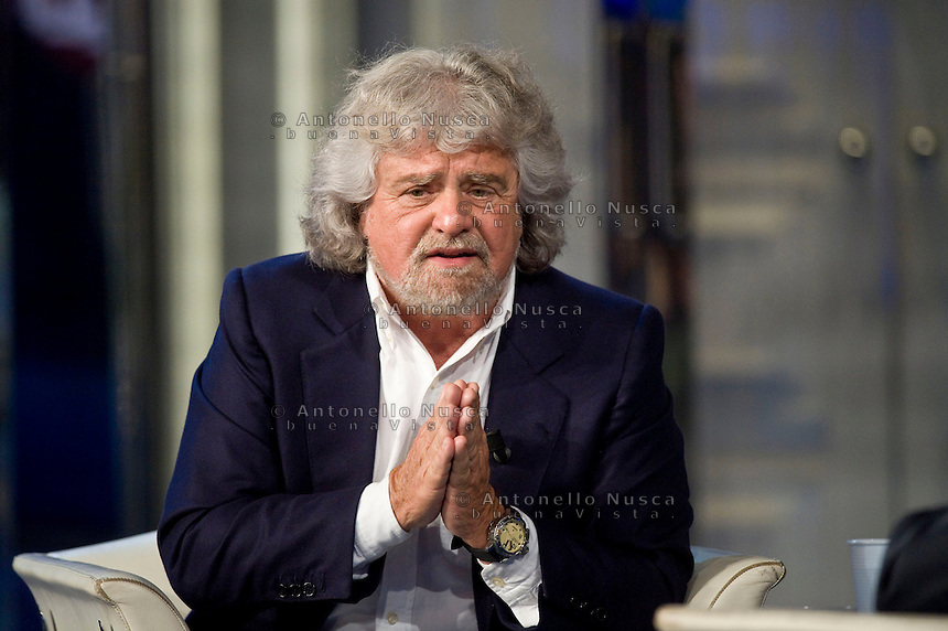 Roma, 19 Maggio, 2014. Beppe Grillo partecipa alla trasmissione Porta a Porta,  ospite di Bruno Vespa negli studi della Rai in occasione della campagna elettorale per le elezioni europee.<br /> Comedian-turned-politician Beppe Grillo attends the 'Porta A Porta' TV show at the RAI TV studios in Rome, Italy. Beppe Grillo is an Italian comedian, actor, blogger and political activist. He has been involved in political activity as founder of the anti-establishment and anti-euro Five Star Movement. The leader vowed to shake up the EU by winning European elections in May.