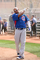 Marlon Byrd #24 of the Chicago Cubs participates in batting practice during spring training workouts at the Cubs complex on February 19, 2011  in Mesa, Arizona. .Photo by Bill Mitchell / Four Seam Images.