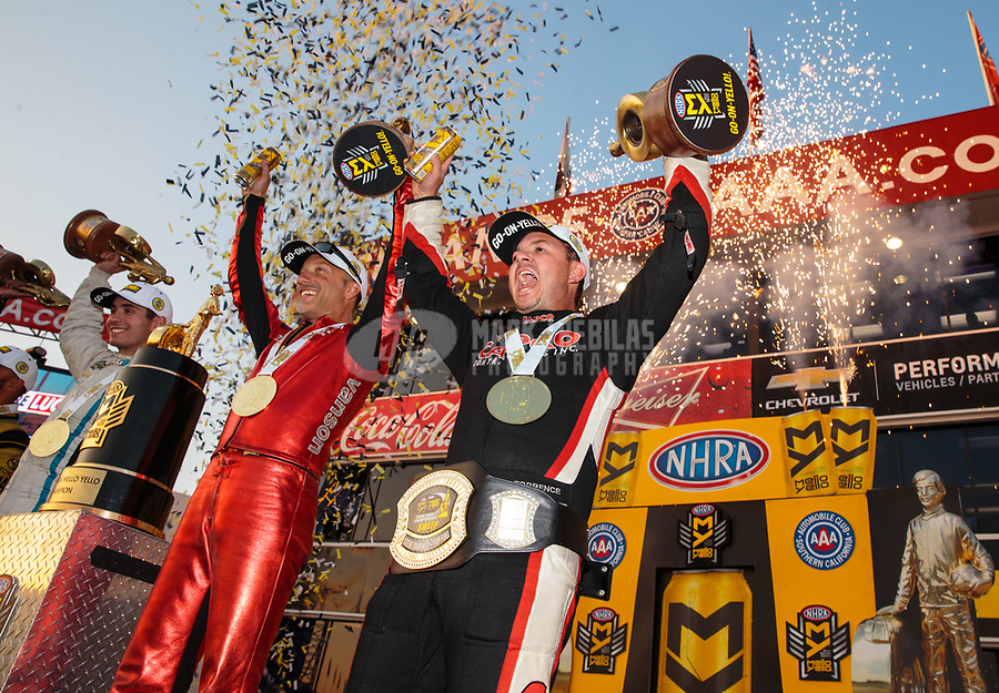 Nov 11, 2018; Pomona, CA, USA; NHRA top fuel driver Steve Torrence (right) celebrates alongside Matt Smith after winning the Auto Club Finals at Auto Club Raceway. Torrence swept all six of the countdown to the championship races to clinch the world championship. Mandatory Credit: Mark J. Rebilas-USA TODAY Sports