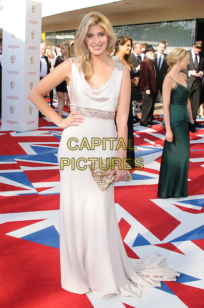 "Francesca ""Cheska"" Hull.Arrivals at the Arqiva British Academy Television Awards held at the Royal Festival Hall, London, England..May 27th, 2012.BAFTA BAFTAS full length white dress hand on hip clutch bag.CAP/CJ.©Chris Joseph/Capital Pictures."