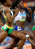 17 AUG 2008 - BEIJING, CHN - Christine Ohuruogu (GBR) - Womens 400m heat - Beijing Olympics. (PHOTO (C) NIGEL FARROW) *** IOC RULES APPLY ON USAGE ***