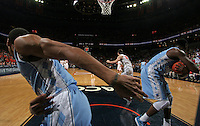 North Carolina  players handle the ball during an NCAA basketball game against Virginia Monday Jan. 20, 2014 in Charlottesville, VA. Virginia defeated North Carolina 76-61.