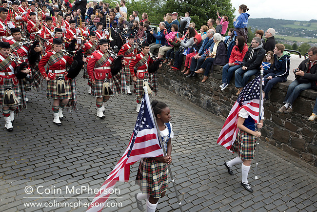 Members of a traditional Scottish pipe band from Dunedin, Florida marching during Pipefest Stirling, an event staged at Stirling Castle to coincide with the 700th anniversary of the Battle of Bannockburn. The event was attended by 1600 pipers, Highland dancers and other musicians and formed a procession through the city's streets. The Battle of Bannockburn took place in 1314 and resulted in the defeat of Edward II's English army by the Scots under Bruce.