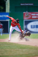 Batavia Muckdogs second baseman Gerardo Nunez (1) attempts to tag Delvin Perez (23) sliding in safely during a game against the State College Spikes on July 8, 2018 at Dwyer Stadium in Batavia, New York.  Batavia defeated State College 8-3.  (Mike Janes/Four Seam Images)
