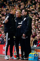 Sunday, 23 February 2014<br /> Pictured: Swansea City's Manager Garry Monk talks to Fourth Official Phil Dowd <br /> Re: Barclay's Premier League, Liverpool FC v Swansea City FC v at Anfield Stadium, Liverpool Merseyside, UK.