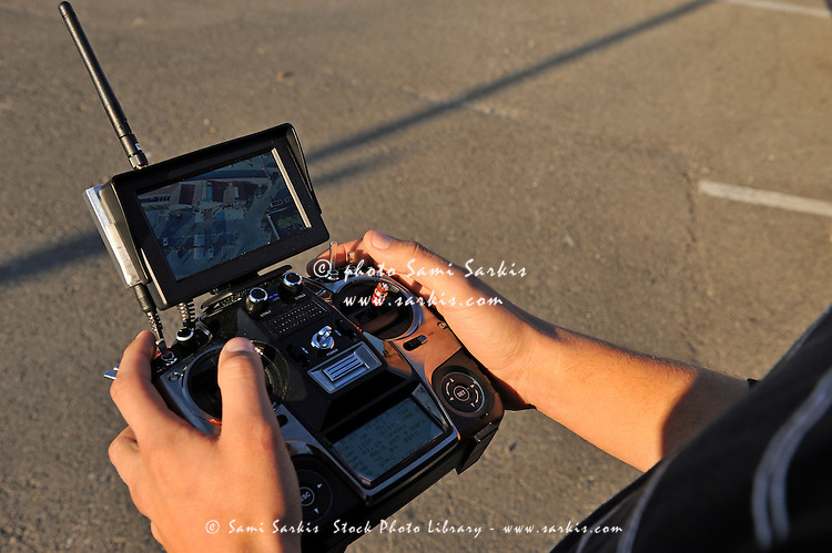 Remote Control and video monitor in hands of the pilot of a UAV or Drone (Unmanned Aerial Vehicle) dediated to Aerial photography