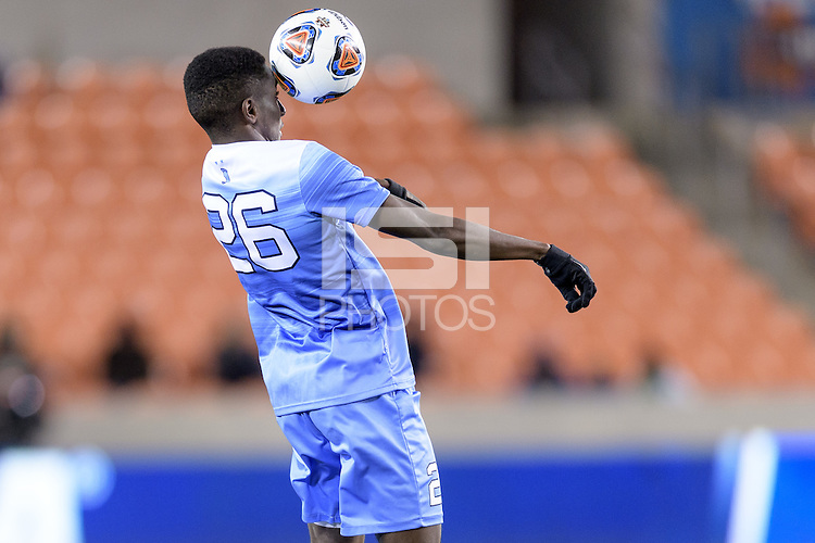 Houston, TX - Friday December 9, 2016: Jelani Pieters (26) of the North Carolina Tar Heels heads the ball towards the Stanford Cardinal goal at the NCAA Men's Soccer Semifinals at BBVA Compass Stadium in Houston Texas.