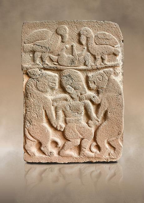 Pictures & images of the North Gate Hittite sculpture stele depicting man with wolves. 8the century BC.  Karatepe Aslantas Open-Air Museum (Karatepe-Aslantaş Açık Hava Müzesi), Osmaniye Province, Turkey. Against art background