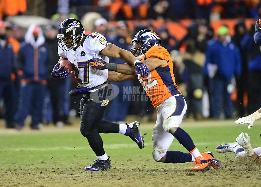 Jan 12, 2013; Denver, CO, USA; Baltimore Ravens running back Ray Rice (27) is pursued by Denver Broncos linebacker Wesley Woodyard (52) in overtime during the AFC divisional round playoff game at Sports Authority Field.  The Ravens defeated the Broncos 38-35 in double overtime. Mandatory Credit: Mark J. Rebilas-