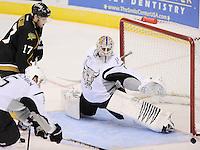 San Antonio Rampage goaltender Dov Grumet-Morris, right, makes a save on Texas Stars' Tomas Vincour (17) during the third period of an AHL hockey game, Saturday, Oct. 13, 2012, in San Antonio. Texas won 2-1. (Darren Abate/pressphotointl.com)