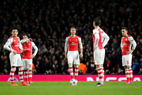 25.02.2015.  London, England. Champions League Football. Arsenal versus AS Monaco.  Arsenal players look dejected after conceding the first goal to make it 0-1