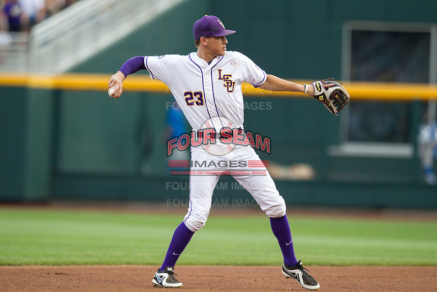 LSU Tigers second baseman JaCoby Jones #23 throws during Game 4 of the 2013 Men's College World Series between the LSU Tigers and UCLA Bruins at TD Ameritrade Park on June 16, 2013 in Omaha, Nebraska. The Bruins defeated the Tigers 2-1. (Brace Hemmelgarn/Four Seam Images)