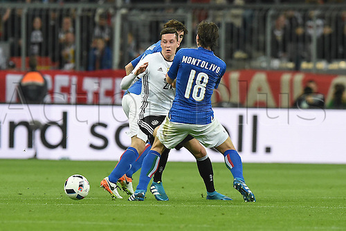 29.03.2016. Munich, Germany. International soccer match between Germany and Italy, at the Allianz Arena in Munich. Matteo Darmian Italy rear Julian Draxler Germany centre Riccardo Montolivo Italy