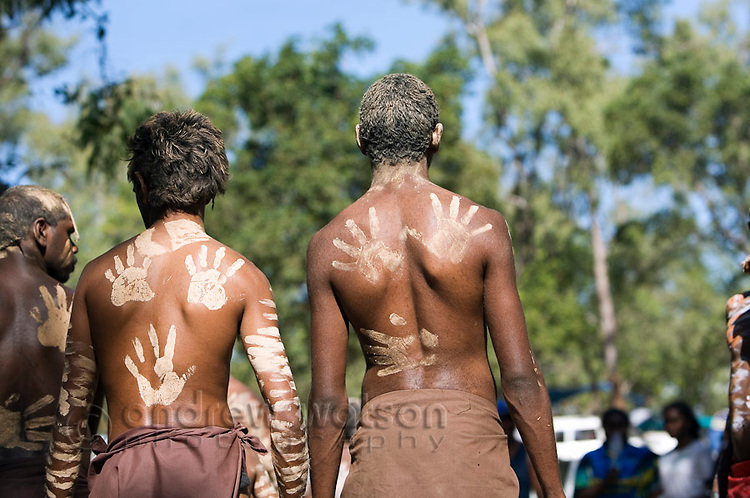 Indigenous dancers with handprint decorations on their backs, at the Laura Aboriginal Dance Festival.  Laura, Queensland, Australia