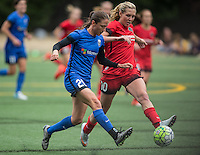 Seattle, WA - Saturday Aug. 27, 2016: Kiersten Dallstream, Allie Long during a regular season National Women's Soccer League (NWSL) match between the Seattle Reign FC and the Portland Thorns FC at Memorial Stadium.