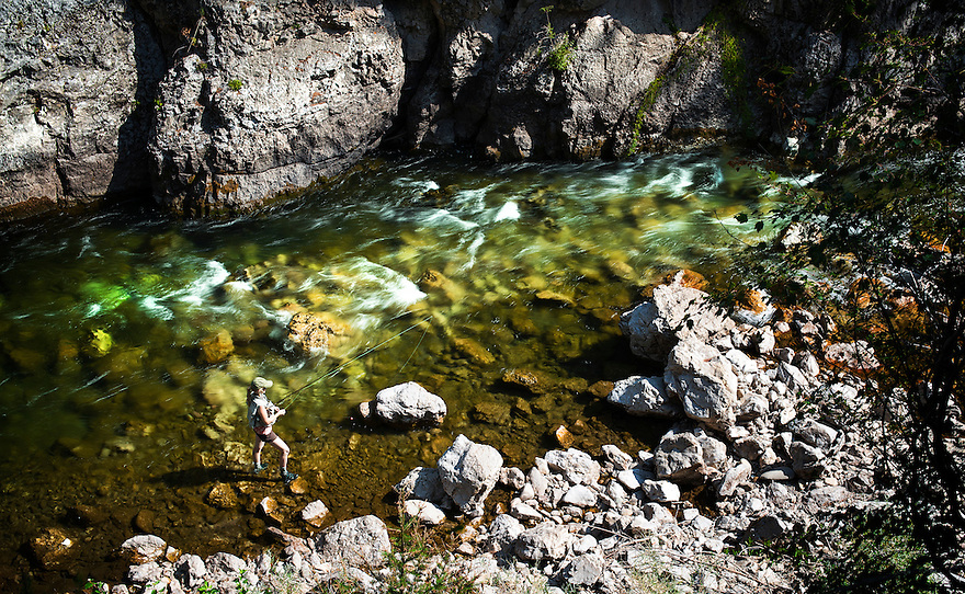 An angler fishes for brown and rainbow trout on Belt Creek in Sluice Boxes State Park near Belt, Montana.