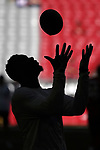 Arizona Cardinals wide receiver Jaron Brown in silhouette before an NFL game captured with the Sony camera a9.