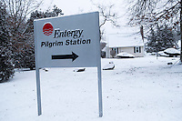 A sign for Pilgrim Station stands near houses in Plymouth, Massachusetts, USA, on Tues., Jan. 31, 2017. Pilgrim Station is a nuclear power plant operated by Entergy.