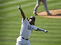 Los Angeles Dodgers Manny Ramirez reacts to his pinch-hit home run against San Francisco Giants in the eighth inning of baseball game in Los Angeles, Sunday, April 18, 2010. (AP Photo/Spencer Weiner)