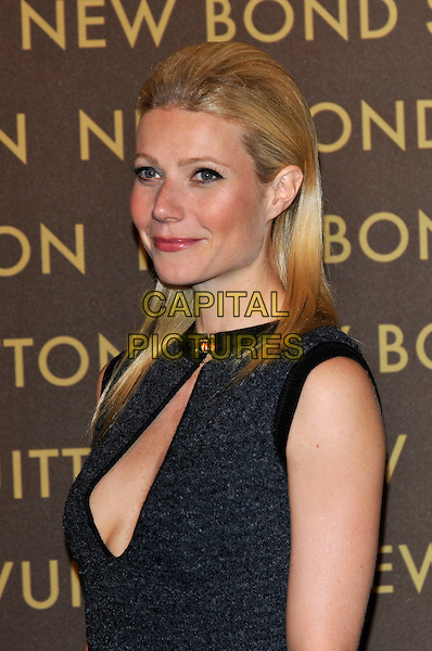 GWYNETH PALTROW .attends the launch of the Louis Vuitton Bond Street Maison Store in London, England, UK, May 25th, 2010. .portrait headshot black grey gray  cut out cleavage sleeveless .CAP/PL.©Phil Loftus/Capital Pictures.