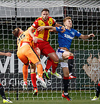 Ross McCrorie amd Jak Alnwick deal with Danny Devine