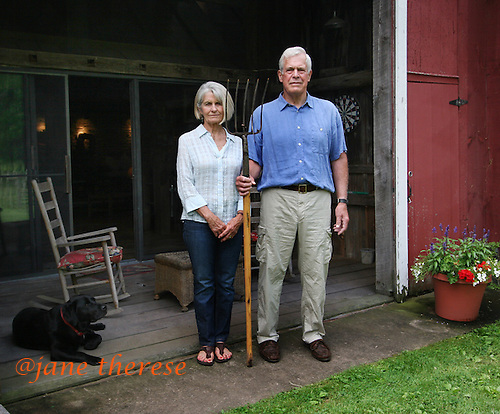 In the true Grant Wood 1930 'American Gothic' style, Karen and Boyce Budd of Erwinna, Pa., pose outside their converted barn a 1-bedroom 2-story living space of on Friday June 10, 2010. The couple rent out the space, as well as use for family holiday gatherings. Jane Therese For The New York Times