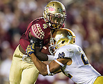 Notre Dame cornerback Cody Riggs, right, stops Florida State running back Dalvin Cook short of the goal line in the third quarter of an NCAA college football game in Tallahassee, Fla., Saturday, Oct. 18, 2014.  AP Photo/Mark Wallheiser)