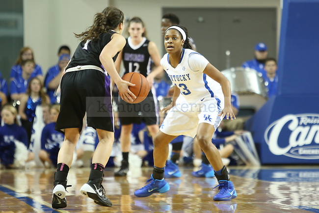 Kentucky Wildcats guard Bria Goss (13) holding off Lipscomb Lady Bisons guard Maya Dillard (1) during the first half of the UK Hoops basketball game vs. Lipscomb on Thursday, November 21, 2013, in Lexington, Ky. Photo by Kalyn Bradford | Staff