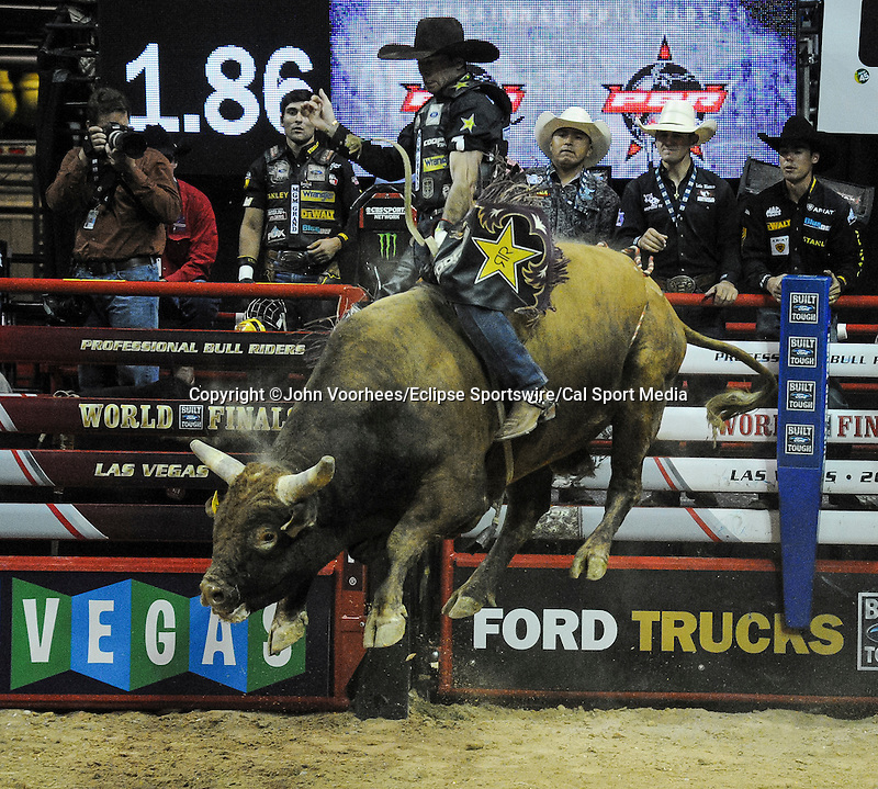 October 25, 2014: Fabiano Vieira rides Hungry Eyes during the PBR Pro Bull Riding Finals at the Thomas and Mack Arena in Las Vegas, Nevada on October 25, 2014. John Voorhees/ESW/CSM
