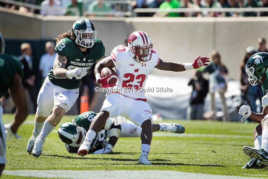 Wisconsin Badgers running back Dare Ogunbowale (23) carries the ball during an NCAA college football game against the Michigan State Spartans Saturday, September 24, 2016, in East Lansing, Michigan. The Badgers won 30-6. (Photo by David Stluka)