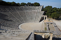 EPIDAURUS, GREECE - APRIL 15 : A general view of the Theatre, on April 15, 2007 in Epidaurus, Greece. The Theatre, designed by Polykleitos the Younger, was built in the late 4th century BC and extended in the Hellenistic period. It was rediscovered in 1881 and significantly restored in the 1950s.  It has the three main features of a Greek theatre: the orchestra, a sunken round stage; the skene, a raised rectangular stage; and the cavea, a raked semi-circular auditorium with radiating diazomas. To the right are the entrances to the two paradoi, or corridors, which gave the actors access to the stage. The theatre is renowned for its accoustics thanks to the symmetry of the cavea, seen here in the morning light. (Photo by Manuel Cohen)