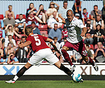 West Ham's Bobby Zamora goes past Roma's Phillipe Mexes. .Pic SPORTIMAGE/David Klein