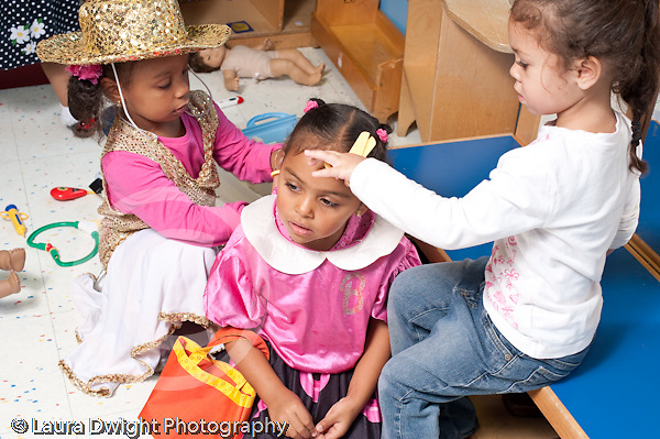 Education preschool 3-4 year olds pretend play dressup three girls playing beauty salon hair cut horizontal