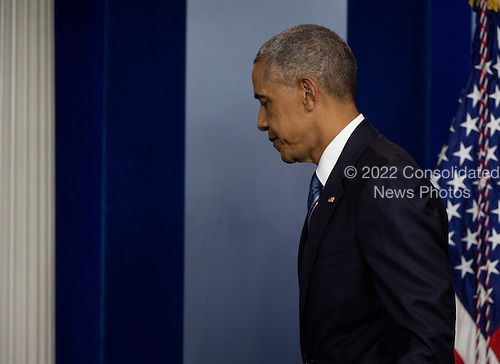 United States President Barack Obama departs after deliver remarks on the US Supreme Court decision on immigration and taking some questions in the press briefing room of the White House in Washington, DC, USA, 23 June 2016.<br /> Credit: Molly Riley / Pool via CNP