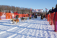 Merissa Osmar leaves the start line of the Junior Iditarod  at Knik Lake, Knik, Alaska