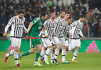 Calcio, Serie A: Juventus vs Inter. Torino, Juventus Stadium, 28 February 2016.<br /> Juventus&rsquo; players, from left, Andrea Barzagli, Gianluigi Buffon, Stefano Sturaro, Leonardo Bonucci, Mario Mandzukic, Alex Sandro and Alvaro Morata greet fans at the end of the Italian Serie A football match between Juventus and Inter at Turin's Juventus Stadium, 28 February 2016. Juventus won 2-0.<br /> UPDATE IMAGES PRESS/Isabella Bonotto