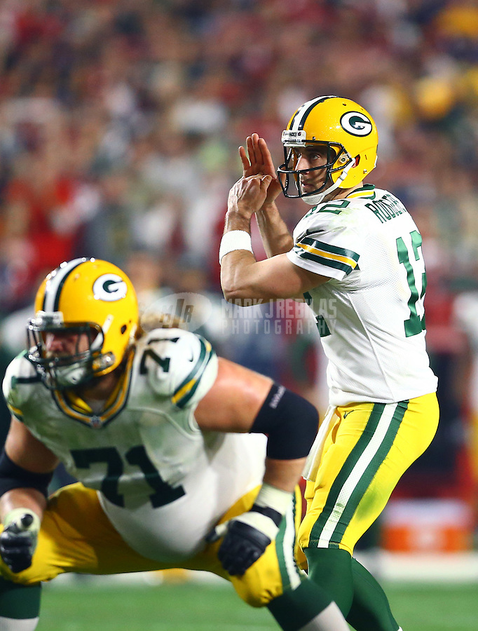 Jan 16, 2016; Glendale, AZ, USA; Green Bay Packers quarterback Aaron Rodgers (12) reacts as he calls a time out against the Arizona Cardinals in the first quarter of a NFC Divisional round playoff game at University of Phoenix Stadium. Mandatory Credit: Mark J. Rebilas-USA TODAY Sports