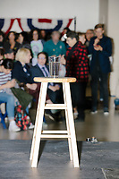 A glass of water for Democratic presidential candidate and Massachusetts senator Elizabeth Warren stands on the stage at a Town Hall campaign event in the Granite State Room in the Memorial Union Building at the University of New Hampshire in Durham, New Hampshire, on Wed., October 30, 2019. Per the campaign, approximately 625 people attended the event, which was part of Warren's 20th trip to the state since Jan. 2019.