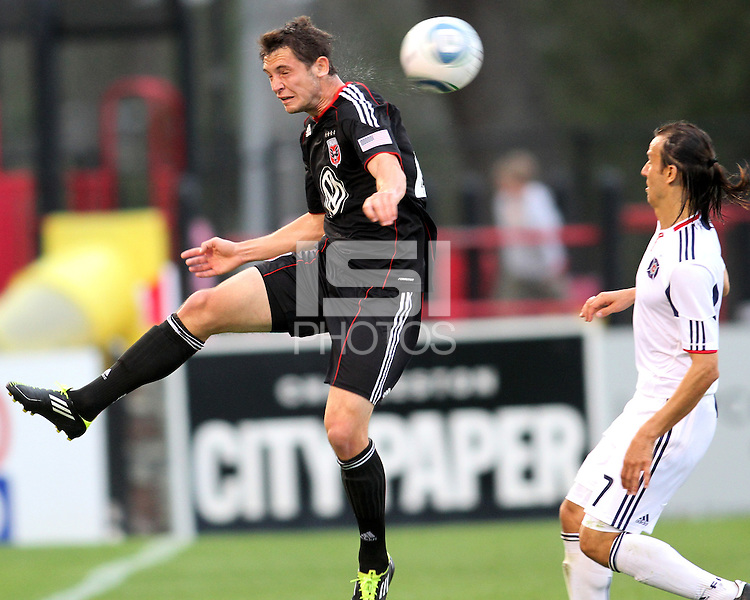 Blake Brettechneider#29 of D.C. United heads away from Bratislav Ristic#77 of the Chicago Fire during a second round match of the Carolina Challenge on March 9 2011 at Blackbaud Stadium, in Charleston, South Carolina. D.C. United won 1-0.