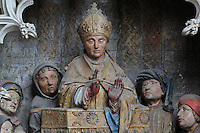 St Saulve praying for the discovery of the tomb of St Firmin, Gothic style polychrome high-relief sculpture from the South side of the choir screen, 1490-1530, commissioned by canon Adrien de Henencourt, depicting the life of St Firmin, at the Basilique Cathedrale Notre-Dame d'Amiens or Cathedral Basilica of Our Lady of Amiens, built 1220-70 in Gothic style, Amiens, Picardy, France. St Firmin, 272-303 AD, was the first bishop of Amiens. Amiens Cathedral was listed as a UNESCO World Heritage Site in 1981. Picture by Manuel Cohen