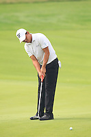 Wu Ashun (CHN) putts on the 10th green during Friday's Round 2 of the 2014 BMW Masters held at Lake Malaren, Shanghai, China 31st October 2014.<br /> Picture: Eoin Clarke www.golffile.ie