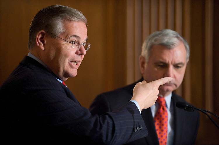 Senate Banking Committee members Sen. Robert Menendez, D-N.J., left, and Sen. Jack Reed, D-R.I., hold a news conference on Tuesday, April 27, 2010, to discuss how Wall Street reform protects consumers and call on Republicans to stop blocking debate in the Senate.