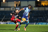 Marcus Bean of Wycombe Wanderers battles George Thomas of Coventry City during the The Checkatrade Trophy Southern Group D match between Wycombe Wanderers and Coventry City at Adams Park, High Wycombe, England on 9 November 2016. Photo by Andy Rowland.